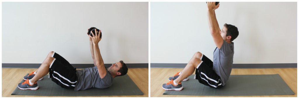 Sit-ups with a dumbbell - AthensTrainers®