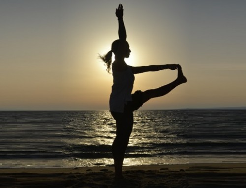 Sunset yoga: standing hand to toe pose